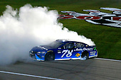 Monster Energy NASCAR Cup Series<br /> Go Bowling 400<br /> Kansas Speedway, Kansas City, KS USA<br /> Saturday 13 May 2017<br /> Martin Truex Jr, Furniture Row Racing, Auto-Owners Insurance Toyota Camry celebrates his win with a burnout<br /> World Copyright: Russell LaBounty<br /> LAT Images<br /> ref: Digital Image 17KAN1rl_5705