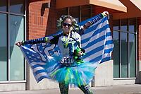 Happy woman Seahawks fan wearing tutu holding 12th man flag, Seahawks 12K Run 2016, The Landing, Renton, Washington, USA.