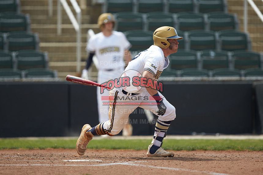 Ryan Dudney (15) of the Queens Royals follows through on his swing against the Mars Hill Lions at Intimidators Stadium on March 30, 2019 in Kannapolis, North Carolina. The Royals defeated the Bulldogs 11-6 in game one of a double-header. (Brian Westerholt/Four Seam Images)