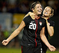 USWNT forward Abby Wambach celebrates her first goal with midfielder Kelley O'Hara. USWNT played played a friendly against Canada at JELD-WEN Field in Portland, Oregon on September 22, 2011.