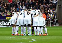 Wednesday, 01 January 2014<br /> Pictured: Swansea players huddle before kick off.<br /> Re: Barclay's Premier League, Swansea City FC v Manchester City at the Liberty Stadium, south Wales.