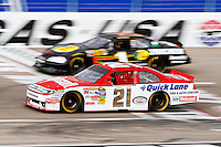 NASCAR stock cars race around Las Vegas Motor Speedway as part of the Dale Jarrett Racing Adventure.