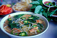 A bowl of Pho, a traditional Vietnamese noodle soup with sliced beef, chili peppers, bean sprouts, and Thai basil, at To-Chau Restaurant, River St., Chinatown, Honolulu