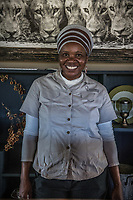 Africa, Botswana, Okavango Delta, Khwai private reserve, woman working at Khwai Private Reserve.