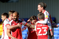 Fleetwood players lift up goalscorer Barrie McKay to celebrate their winning goal during AFC Wimbledon vs Fleetwood Town, Sky Bet EFL League 1 Football at Plough Lane on 5th April 2021