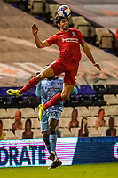 20th November 2020; St Andrews Stadium, Coventry, West Midlands, England; English Football League Championship Football, Coventry City versus Birmingham City; George Friend of Birmingham City jumps high to head the ball forward