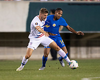 PHILADELPHIA, PA - JUNE 30: Walker Zimmerman #5 and Kenji Gorre #14 vie for the ball during a game between Curacao and USMNT at Lincoln Financial Field on June 30, 2019 in Philadelphia, Pennsylvania.