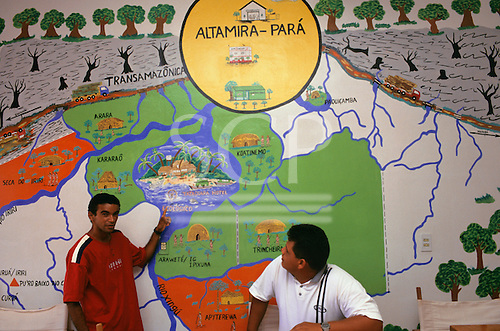 Altamira, Amazon, Brazil. Amazoncoop internet cafe; owned by six Indian tribes; Francisco with his mural map of the area.