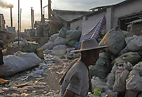 A migrant worker who sorts through waste in trash for a living in a town called Lin Jiao in China. Lin Jiao near Nanhai in China's Guangdong Province is a heavily polluted township that recycles waste plastic, much of which is brought from European countries..30 Aug 2006