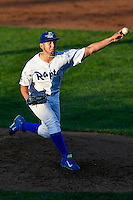 Ogden Raptors starting pitcher Jairo Pacheco (11) delivers a pitch to the plate against the Grand Junction Rockies in Pioneer League action at Lindquist Field on June 20, 2016 in Ogden, Utah. The Rockies defeated the Raptors 5-2. (Stephen Smith/Four Seam Images)