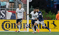 FOXBOROUGH, MA - JUNE 27: Carles Gil #22 dribbles as Jack Elliott #3 and Raymon Gaddis #28 close during a game between Philadelphia Union and New England Revolution at Gillette Stadium on June 27, 2019 in Foxborough, Massachusetts.