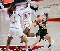 COLLEGE PARK, MD - DECEMBER 8: Laryn Edwards #2 of Loyola holds the ball away from Shakira Austin #1 of Maryland during a game between Loyola University and University of Maryland at Xfinity Center on December 8, 2019 in College Park, Maryland.