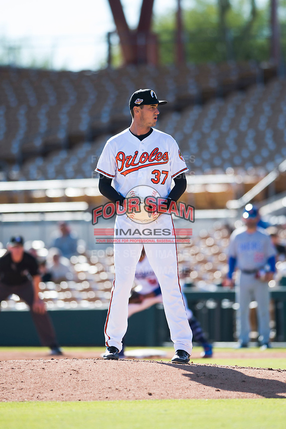 Glendale Desert Dogs relief pitcher Tanner Chleborad (37), of the Baltimore Orioles organization, gets ready to deliver a pitch during an Arizona Fall League game against the Mesa Solar Sox at Camelback Ranch on November 12, 2018 in Glendale, Arizona. Glendale defeated Mesa 4-2. (Zachary Lucy/Four Seam Images)