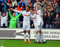 FAO SPORTS PICTURE DESK<br /> Pictured: Joe Allen of Swansea (C) celebrating his goal with team mates Scott Sinclair (L) and Danny Graham (R). Saturday, 28 April 2012<br /> Re: Premier League football, Swansea City FC v Wolverhampton Wanderers at the Liberty Stadium, south Wales.
