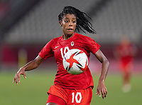 KASHIMA, JAPAN - AUGUST 2: Ashley Lawrence #10 of Canada runs to the ball during a game between Canada and USWNT at Kashima Soccer Stadium on August 2, 2021 in Kashima, Japan.