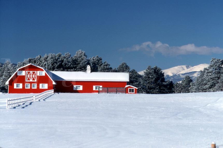 Red barn in winter snow.
