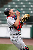 Lehigh Valley IronPigs catcher Erik Kratz #19 catches a pop up in foul territory during a game against the Rochester Red Wings at Frontier Field on April 22, 2012 in Rochester, New York.  Rochester defeated Lehigh Valley 3-2.  (Mike Janes/Four Seam Images)