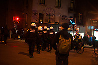 April 7, 2014 - Police surround angry protester on the Quebec election night<br /> <br /> There was a small march of Parti Quebecois supporters in downtown Montreal, when it was offically announced on TV that the PQ had lost the election to the Liberal Party of Quebec led by Philippe Couillard.<br /> <br /> Photo : Philippe Nguyen<br />  - Agence Quebec Presse