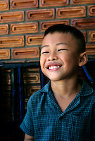 Portrait of a young smiling boy on the island of Ko Samui, Thailand.