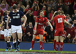 Dan Biggar celebrates with Liam Williams after the Wales full back scores in the corner.<br /> RBS 6 Nations 2014<br /> Wales v Scotland<br /> Millennium Stadium<br /> <br /> 15.03.14<br /> <br /> ©Steve Pope-SPORTINGWALES