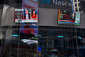 New York, New York<br /> March 18, 2020<br /> 11:19 AM<br /> <br /> Manhattan under coronavirus pandemic. <br /> <br /> The Nasdaq building in Times Square broadcasts another day of losses on Wall Street as the Dow drops more than 1,000 point.