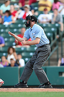 Umpire Joseph Born makes a call during the second game of a doubleheader between the Buffalo Bisons Rochester Red Wings on July 6, 2014 at Frontier Field in Rochester, New  York.  Rochester defeated Buffalo 6-1.  (Mike Janes/Four Seam Images)