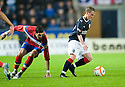 FALKIRK'S CRAIG SIBBALD GETS AWAY FROM RANGERS' KYLE LAFFERTY