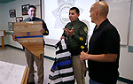 Sgt. Steve Olson and Lt. Daniel Gonzales honor retiring Capt. Brian Humphrey during a ceremony at Carson City Sheriff's Office, in Carson City, Nev., on Thursday, July 2, 2020. <br /> Photo by Cathleen Allison