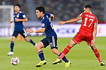 Doan Ritsu of Japan (L) is challenged by Ali Al Busaidi of Oman during the AFC Asian Cup UAE 2019 Group F match between Oman (OMA) and Japan (JPN) at Zayed Sports City Stadium on 13 January 2019 in Abu Dhabi, United Arab Emirates. Photo by Marcio Rodrigo Machado / Power Sport Images