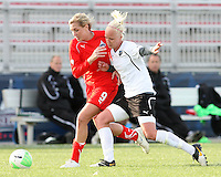 Allie Long #9 of the Washington Freedom pushes off against Caroline Seger #9 of the Philadelphia Independence during a WPS pre season match at the Maryland Soccerplex on March 27 2010 in Boyds, maryland