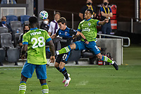 SAN JOSE, CA - OCTOBER 18: Carlos Fierro #21 of the San Jose Earthquakes is tackled by Jordy Delem #8 of the Seattle Sounders during a game between Seattle Sounders FC and San Jose Earthquakes at Earthquakes Stadium on October 18, 2020 in San Jose, California.