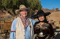 Calico Ghost Town Barstow CA California  sherriff and lady in costume for tourists in  old cowboy town of the 1800's cowboys 5 6