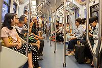 Bangkok, Thailand.  Skytrain Passengers in Car.