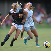NWA Democrat-Gazette/ANDY SHUPE<br /> Arkansas' Stefani Doyle (left) and Penn State's Maddie Elliston vie for the ball Friday, Aug. 25, 2017, during the Razorbacks' 4-2 loss at Razorback Field in Fayetteville. Visit nwadg.com/photos to see more photographs from the match.