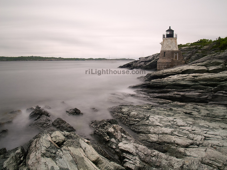 Castle Hill Lighthouse sits quietly on a cold gray morning overlooking misty waves.