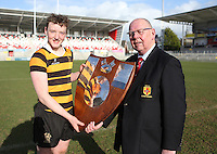 MEDALLION SHILED FINAL   Monday 10th March 2015<br /> <br /> RBAI skipper Ethan Glover and Ulster Branch Senior  Branch President Bobby Stewart with the Medallion Shield after the 2015 Ulster Schools Medallion Shield Final at the Kingspan Stadium, Ravenhill Park, Belfast.<br /> <br /> Picture credit: John Dickson / DICKSONDIGITAL