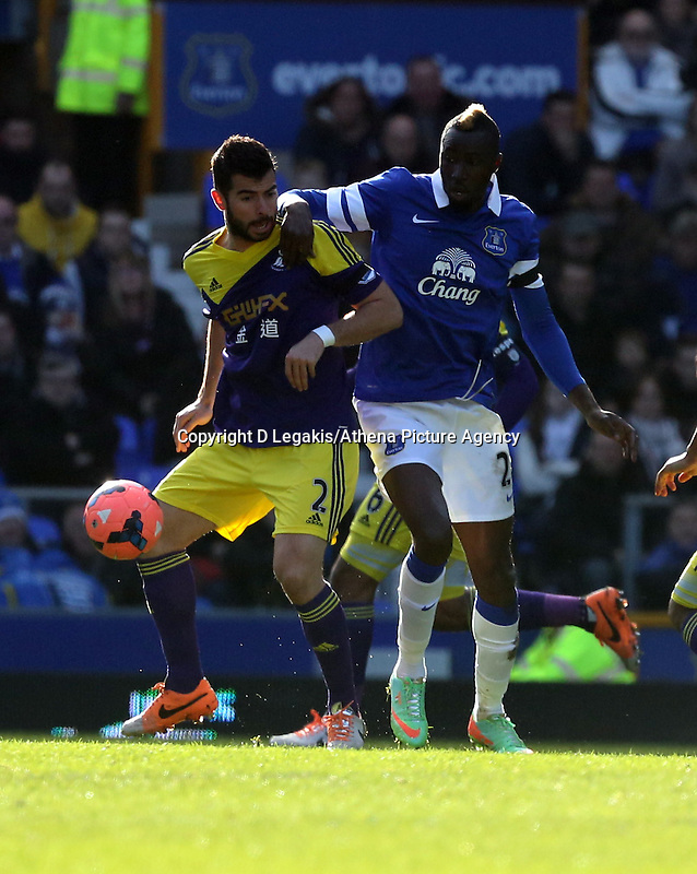 Pictured L-R: Jordi Amat challenged by Lacina Traore of Everton. Sunday 16 February 2014<br /> Re: FA Cup, Everton v Swansea City FC at Goodison Park, Liverpool, UK.
