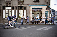 eventual race winner Dylan van Baarle (NED/INEOS Grenadiers) during his 50km solo passing by these local butchershop employees who ALWAYS stop working and come out to cheer the riders on every time a race passes by (which is every few days this time of year...)<br /> <br /> 76th Dwars door Vlaanderen 2021 (MEN1.UWT)<br /> 1 day race from Roeselare to Waregem (184km)<br /> <br /> ©kramon