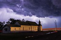 Church at Night under a Purple Thunderstom Cloud backlit by Lightning near Chapman, KS