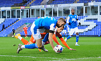 Blackpool's Jerry Yates vies for possession with Peterborough United's Mark Beevers<br /> <br /> Photographer Chris Vaughan/CameraSport<br /> <br /> The EFL Sky Bet League One - Peterborough United v Blackpool - Saturday 21st November 2020 - London Road Stadium - Peterborough<br /> <br /> World Copyright © 2020 CameraSport. All rights reserved. 43 Linden Ave. Countesthorpe. Leicester. England. LE8 5PG - Tel: +44 (0) 116 277 4147 - admin@camerasport.com - www.camerasport.com