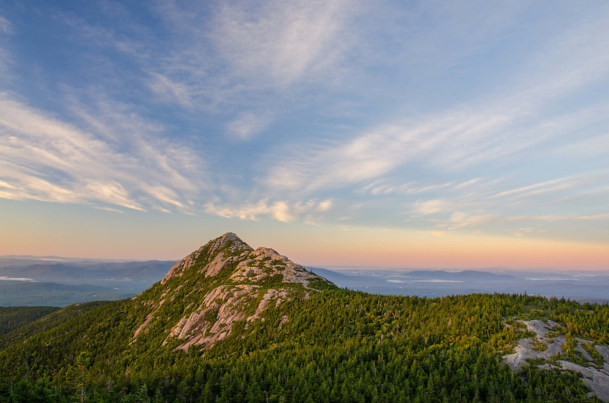 Dawns first light breaks like a wave over Mount Chocorua, White Mountains of New Hampshire.