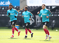 1st May 2021; Liberty Stadium, Swansea, Glamorgan, Wales; English Football League Championship Football, Swansea City versus Derby County; Nathan Byrne of Derby County warms up with team mates Colin Kazim-Richards and George Edmundson