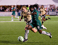 St. Louis Athletica forward Enoila Aluko (9) stays in front of FC Gold Pride defender Rachel Buehler (4) during a WPS match at Korte Stadium, in St. Louis, MO, May 9 2009.  St. Louis Athletica won the match 1-0.