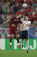 Portuguese forward (17) Cristiano Ronaldo goes up for a header against English defender (6) John Terry.  Portugal defeated England on penalty kicks after playing to a 0-0 tie in regulation in their FIFA World Cup quarterfinal match at FIFA World Cup Stadium in Gelsenkirchen, Germany, July 1, 2006.