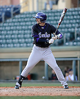 Center fielder Julian Ridings (4) of the Western Carolina Catamounts in a game against the Cincinnati Bearcats on Sunday, February 24, 2013, at Fluor Field in Greenville, South Carolina. Cincinnati won in 10 innings, 7-6. (Tom Priddy/Four Seam Images)