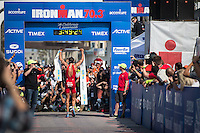 Jan Frodeno celebrates a decisive win in the Accenture Ironman California 70.3 in Oceanside, CA on March 29, 2014.