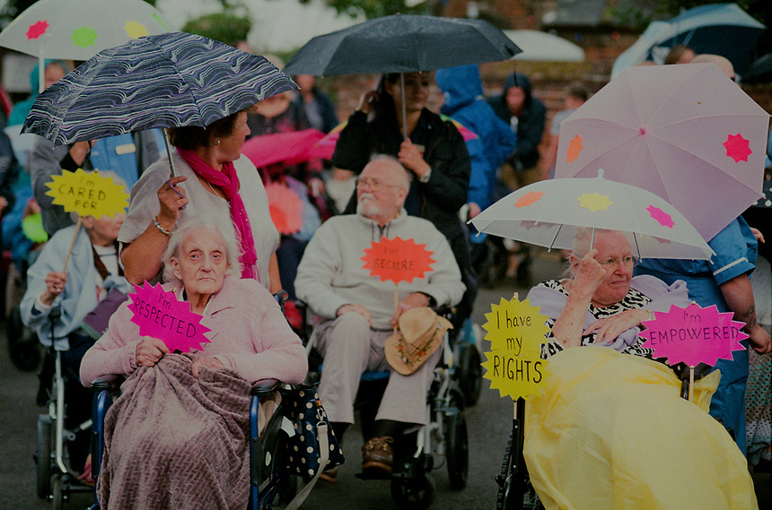 Care homes residents dsiplaying signs affirming their dignity.