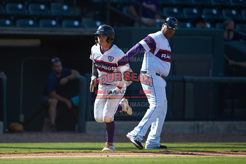 Tyler Frost (5) of the Winston-Salem Rayados slaps hands with third base coach Jamie Dismuke (33) after hitting a home run against the Lynchburg Hillcats at BB&T Ballpark on June 23, 2019 in Winston-Salem, North Carolina. The Hillcats defeated the Rayados 12-9 in 11 innings. (Brian Westerholt/Four Seam Images)