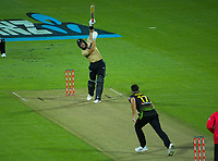 NZ's Martin Guptill skies a Marcus Stoinis delivery during the third international men's T20 cricket match between the New Zealand Black Caps and Australia at Sky Stadium in Wellington, New Zealand on Wednesday, 3 March 2021. Photo: Dave Lintott / lintottphoto.co.nz