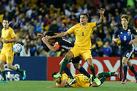 October 11, 2016: TIM CAHILL (4) of Australia fouls MAKOTO HASEBE (17) of Japan during a 3rd round Group B World Cup 2018 qualification match between Australia and Japan at the Docklands Stadium in Melbourne, Australia. Photo Sydney Low Please visit zumapress.com for editorial licensing. *This image is NOT FOR SALE via this web site.